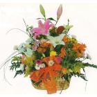 Cesta  flores colores calidos